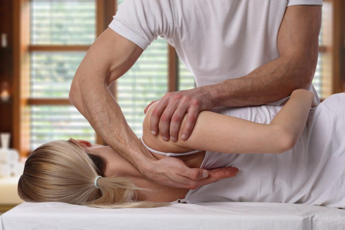 woman receiving chiropractic care adjustment from a chiropractor
