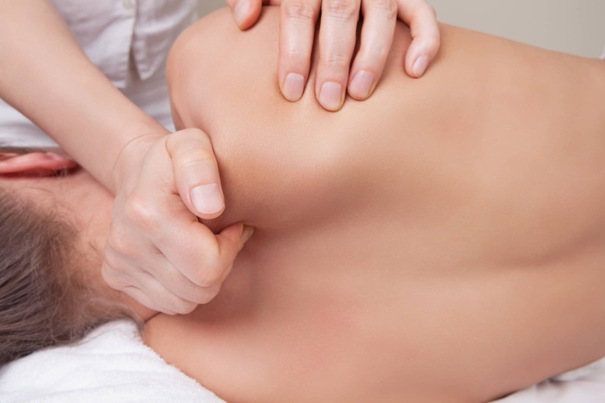 massage therapist working on a patient a masseuse