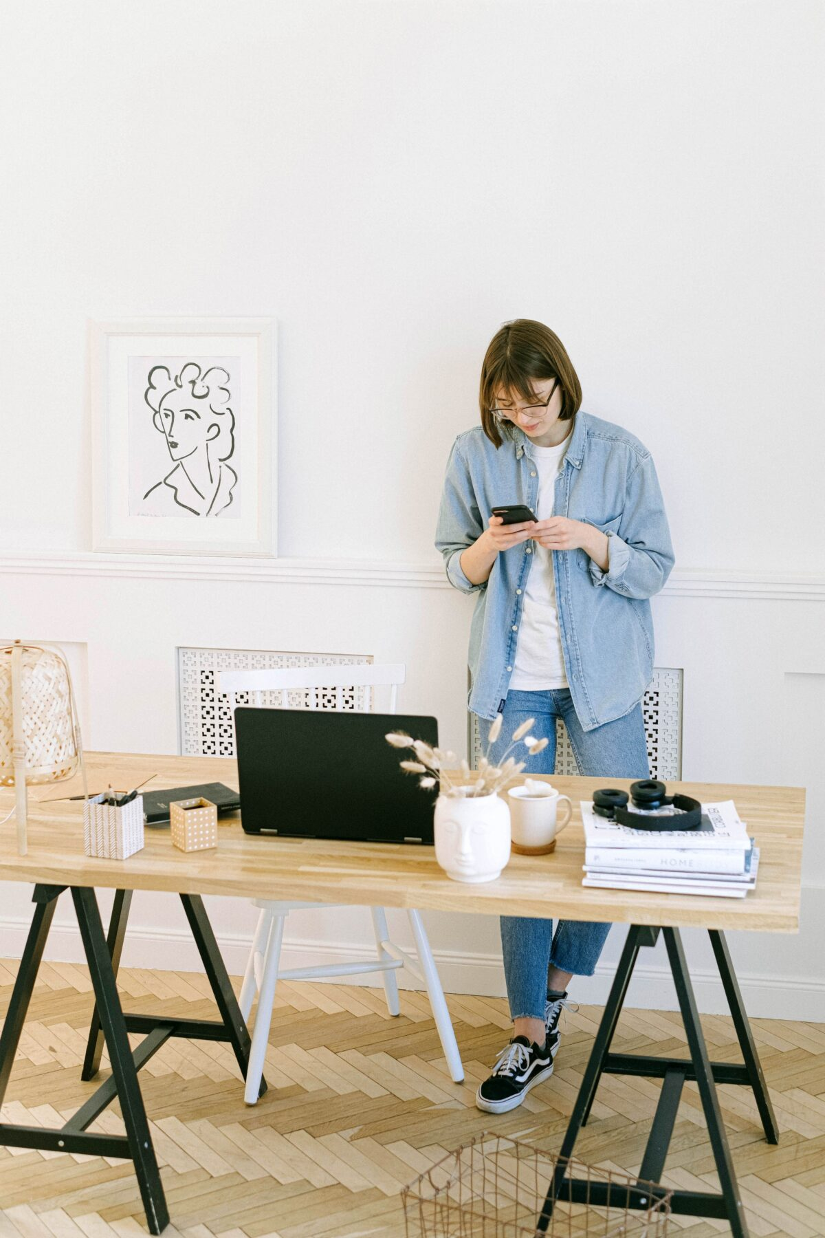 woman standing next to home office desk