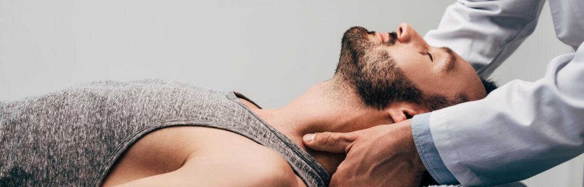 Man getting neck massage or adjustment