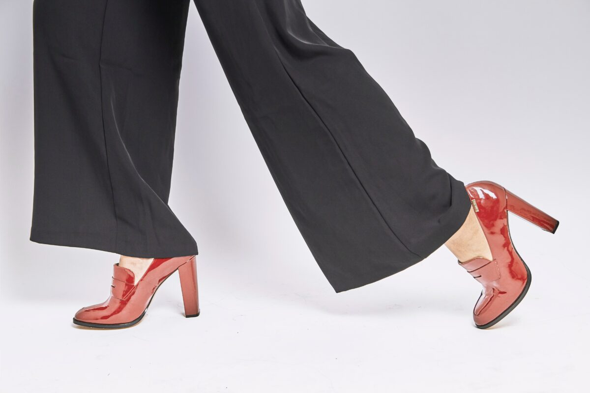Do your back a favor and switch out the high heels for some flats.